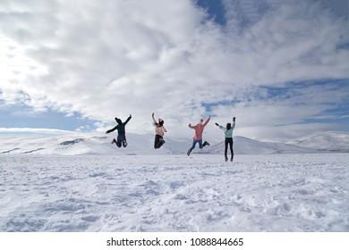 Girls jumping on the frozen Cildir Lake, Ardahan nearby Kars.