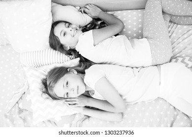 Girls just want to have fun. Invite friend for sleepover. Best friends forever. Consider theme slumber party. Slumber party timeless childhood tradition. Girls relaxing on bed. Slumber party concept.