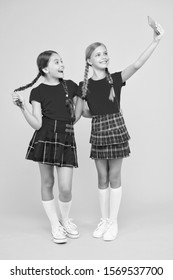 Girls just want to have fun. Schoolgirls use mobile phone smartphone taking photo. Selfie photo for social networks. Born to be internet superstar. Girls take selfie smartphone. Take perfect photo.