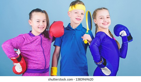 Girls kids with boxing sport equipment and boy tennis player. Ways to help kids find sport they enjoy. Sporty siblings. Friends ready for sport training. Child might excel completely different sport.