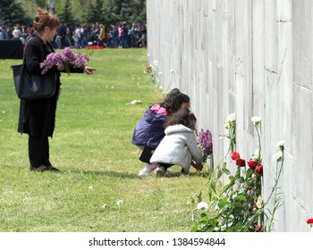 Girls lay flowers at the manger memory Nagorno-Karabakh, Armenia, 24 April 2019.Torchlight processions in memory of the Armenian genocide victims.