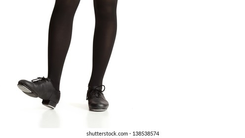 Girl's Legs and Feet Posing in Tap Shoes and Black Tights
