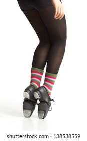 Girl's legs and feet in tap shoes and colorful socks