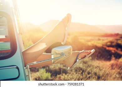 girl's legs in a retro car  at sunset, retro style.