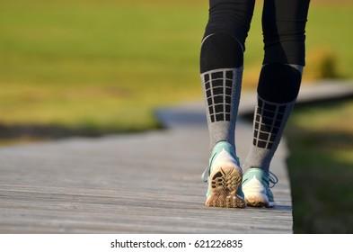 girl's legs in running shoes