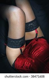girl's legs in sexy black fishnet stockings