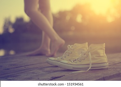 The girl's legs and sneakers