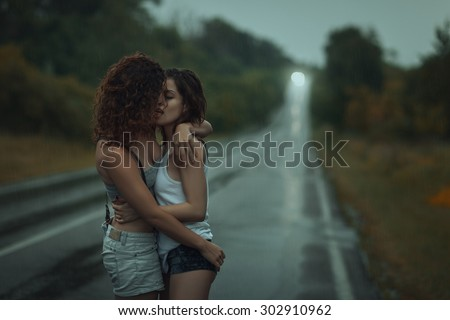 Young girls kissing ass