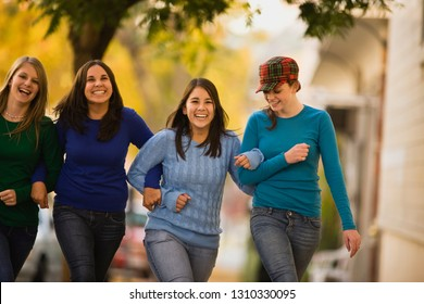 Girls linking arms and walking