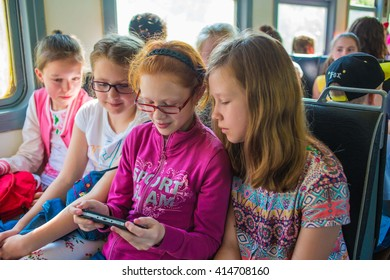 "Girls looking tablet computer. The children go on vacation on the Train Yaroslavl -Kostroma in children's camp ""Berezka""  23.05.2015. editorial"