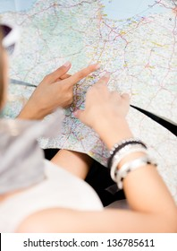 Girls lost their way and check the way with the help of the highway map