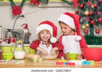 The girls make cookies for Christmas