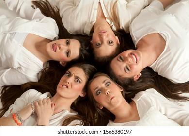 girls making faces, looking at camera