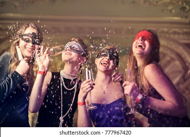 Girls at a masked party