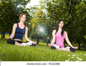 Girls meditating in the park