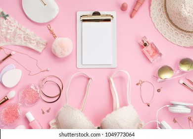 Girls morning ritual concept. Summer style in pink pastel colors. Lace lingerie, cosmetics and accessories