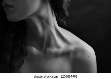 Girl's neck wtih dramatic light.