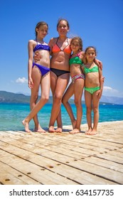 Girls on the wooden pier in the sea