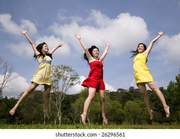 girls in the outdoor jumping happily