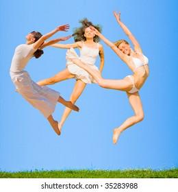 Girls over grass