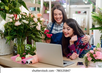 Girls overwhelmed by excellent news. Two florists, owners of the shop, got an expensive order to fulfill. Small floristry business development.