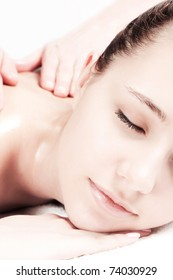 Girl's part of face during massage procedure.