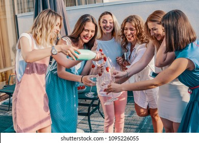 Girls Party. Beautiful Women Friends Having Fun At Bachelorette Party. They are Celebrating And Drinking Champagne At Hen Party. Cheers