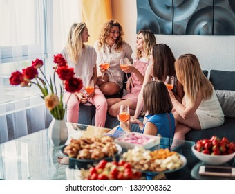 Girls Party. Beautiful Women Friends Having Fun At Bachelorette Party. They are Celebrating And Drinking Champagne At Hen Party. They are talking
