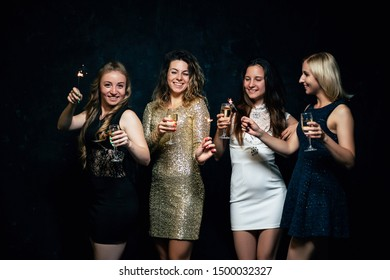 Girls party. Closeup of glasses with champagne. Young ladies celebrating, having fun together. Women night out concept, hen party