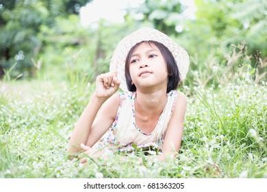 Girls play in the grass garden.