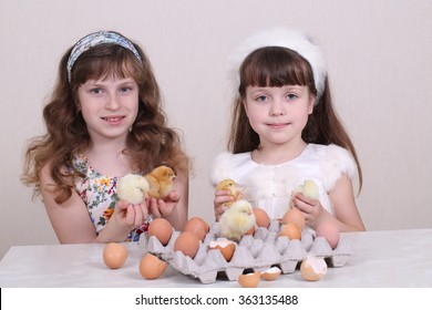 Girls play with live small chickens