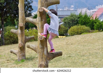 Girls playing with athletics at tree climbing