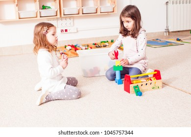 Girls are playing with cubes