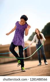 Girls playing jumprope.