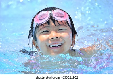 Girls playing in the swimming pool