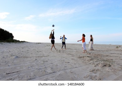Girls playing volleyball in beach