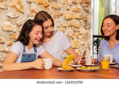 Girls posing for selfie during family breakfast