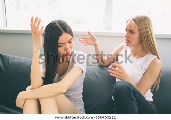 girls quarrel. Women talking loudly about something.