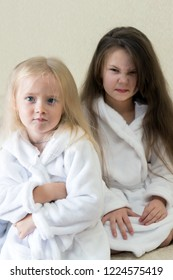 The girls quarreled quarreled among themselves. The quarrel between the two sisters disgruntled evil faces emotions of children.