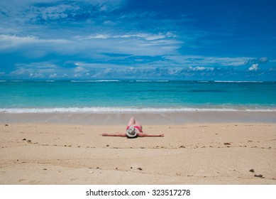 The girls relax on a Sunny and deserted beach
