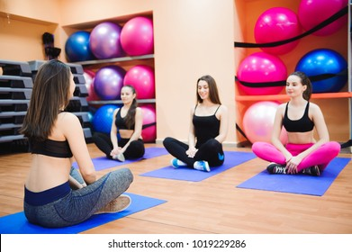 girls relax sitting on the floor in the gym