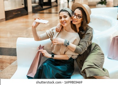 Girls are resting on the couch in the mall. Shopping, entertainment and leisure. Break in purchases