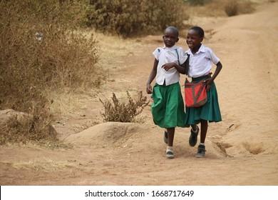 Girls returning from school near Mwanza, Tanzania, August 21, 2019
