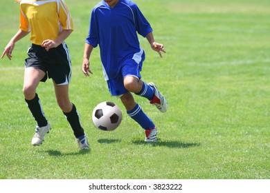 Girls running after the ball in a soccer match