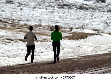 Girls Running Along Gravel Road in Wyoming