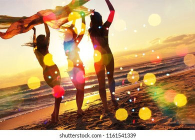 Girls running on Beach, having Party at golden Summer sunset background