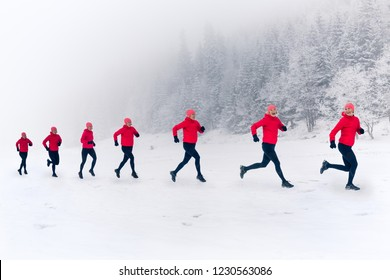 Girls running together on snow in winter mountains. Sport, fitness inspiration and motivation. Happy group of women trail running in mountains, winter day. Multiple female trail runners on snow