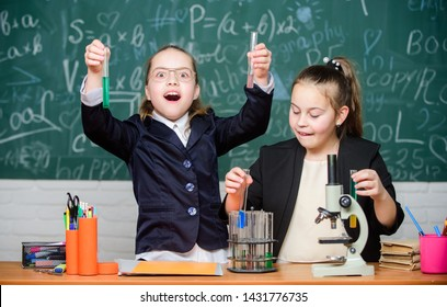 Girls school uniform busy with proving their hypothesis. School experiment. Science concept. Gymnasium students with in depth study of natural sciences. Private school. School project investigation.