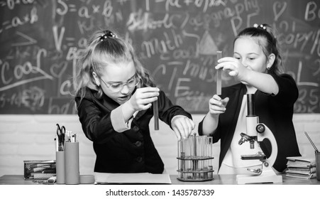 Girls school uniform excited proving their hypothesis. Gymnasium students with in depth study of natural sciences. School project investigation. School experiment. School for gifted children.