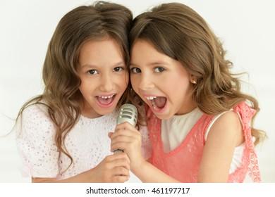 girls  singing in karaoke